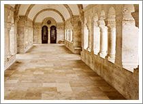 stone corridor of arched columns