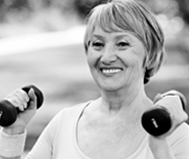 Photo of smiling woman holding small weights