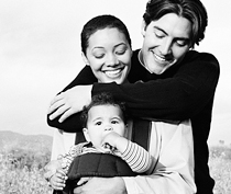 Photo of young family embracing